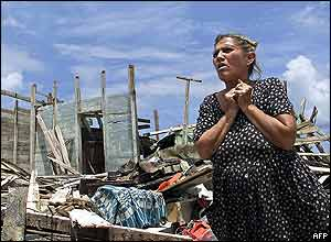 A Cuban woman stands by the ruins of her house, destroyed by the hurricane
