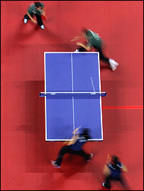 Algeria (green) and Tunisia compete during the women's doubles table tennis match
