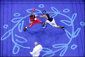 Urkirbek Haydarov (blue) lands a punch against Isaac Ekpo