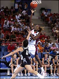 America's Sheryl Swoopes scores over the top of Leanne Walker