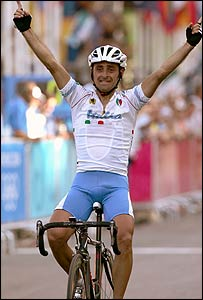 Italy's Paolo Bettini celebrates winning the men's cycling road race
