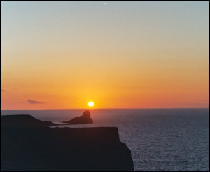 The sun setting behind the Worms Head, Gower (Joanna Walker, New York)