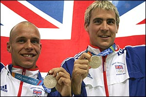 Peter Waterfield and Leon Taylor pose in front of a union jack