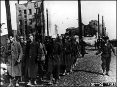 The end of Warsaw's uprising sees a group of city defenders marched off to prison camps by their German captors