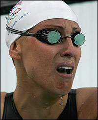 Sarah Price cries after injuring herself before the 100m backstroke semi-final