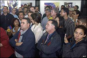 Opposition supporters watch results on television