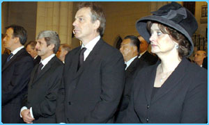 Prime Minister Tony Blair and his wife Cherie join the mourners