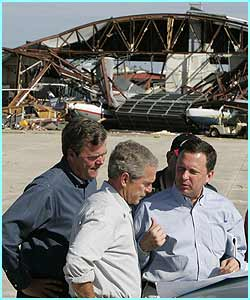 President Bush and his brother, Florida Governor Jeb Bush, assess the damage at an airport