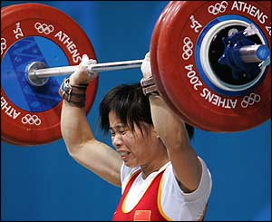 Chen Yanqing grimaces as she attempts to break the world record