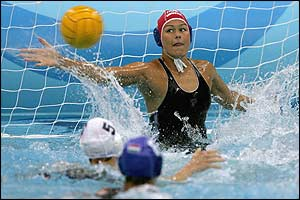 Hungary's goalkeeper Ildiko Zirighne Sos tries to block a shot