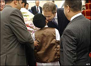 Tony Blair met by Libyan boy