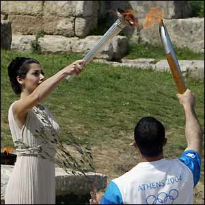 Greek actress Thalia Prokopiou lights the Olympic torch at the Temple of Hera
