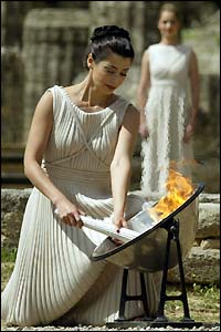 Greek actress Thalia Prokopiou lights the torch at the Temple of Hera