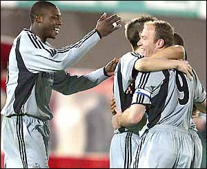 Alan Shearer (right) celebrates with his Newcastle team mates