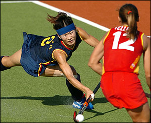 Fu Baorong of China fires a shot towards goal