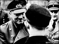 In his last official photo, Adolf Hitler leaves the safety of his bunker to award decorations to members of Hitler Youth