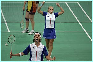Badminton pair Nathan Robertson and Gail Emms celebrate after beating Denmark and sealing a place in the mixed doubles final.