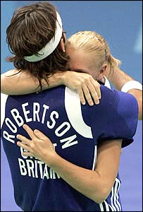 Mixed doubles Robertson and Emms hug after beating Denmark
