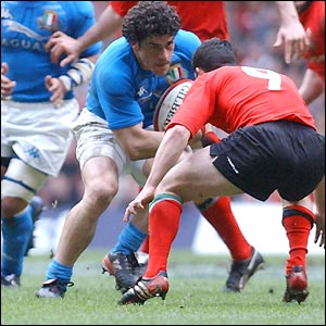 Italy's Andrea Masi comes face to face with Wales' Gareth Cooper