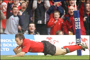 Rhys Williams dives over in the corner  to score Wales' second try