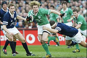 Brian O'Driscoll is tackled by Scotland's Bruce Douglas