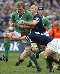 Paul O'Connell is tackled by Scotland's Chris Cusiter and Simon Webster