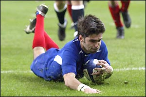 France's Dimitri Yachvili scores a try and kicks 11 points during the first half