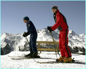 Father and son take to the slopes. On your marks, get set, go!