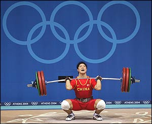 Liu Chunhong attempts a lift in the clean and jerk portion