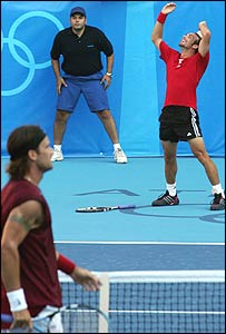 Massu (right) celebrates beating Moya (left)