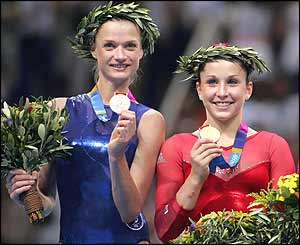 Svetlana Khorkina (left) with her silver medal and Carly Patterson with her gold