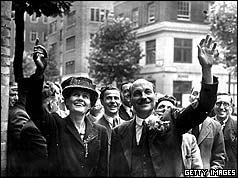 British Prime Minister Clement Attlee (1883 - 1967) and his wife waving to crowds on their arrival at Transport House, London.