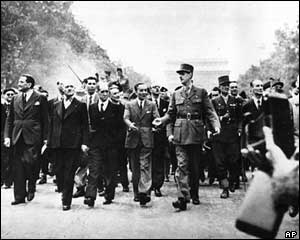 General Charles de Gaulle leads a parade through the streets of Paris