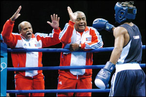 Yuriokis of Cuba is congratulated by his corner men