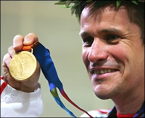Germany's Ralf Schumann shows off his gold medal