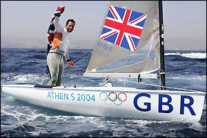 Ben Ainslie punches the air in delight after securing gold in the Finn class