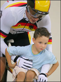German Jens Fiedler carries his son on his bike