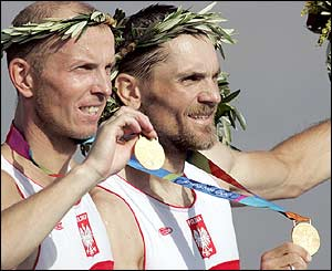 Poland's Tomasz Kucharski and Robert Sycz celebrate winning the gold medal in the lightweight men's double sculls final