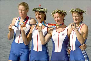 Alison Mowbray, Debbie Flood, Frances Houghton and Rebecca Romero celebrate on the podium after winning the silver medal in the women's quadruple sculls