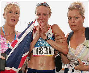 Paula Radcliffe is consoled by friends