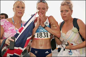 Two of Paula Radcliffe's supporters offer the British star some help