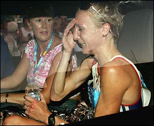 A tearful Paula Radcliffe is driven from the track