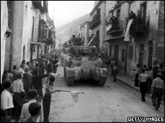 Residents of Palermo, Sicily, line the streets to greet the American Sherman tanks after the town had surrendered to the Allies.