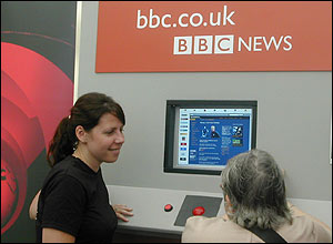 A BBC journalist demonstrates the BBC on the internet