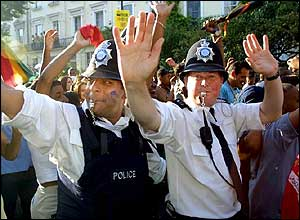 Policeman join the revellers in 2001