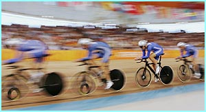 Cycling team Steve Cummings, Paul Manning, Chris Newton and Bradley Wiggins in action before finishing second to win the silver medal in the men's track cycling team pursuit final against Australia.