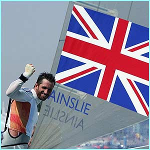 Ben Ainslie celebrates winning the men's single handed dinghy finn finals race