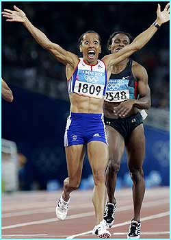 Kelly Holmes is overjoyed after winning gold in the women's 800m race in spectacular style.