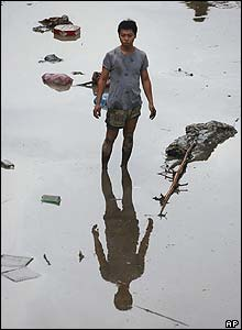 A Taiwanese man surveys the damage caused by the Typhoon Aere