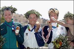 Loretta Harrop, Kate Allen and bronze medal-winner Susan Williams of the USA with her young daughter
